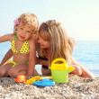 Stock Photo: Child and mother on beach