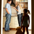 Child looks at the swearing parents - Stockfoto