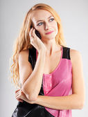 Beautiful woman talking on mobile phone — Stok fotoğraf