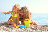 Child and mother on beach — Stock Photo