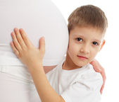 Child a listening stomach of pregnant mother — Stock Photo