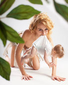Primitive woman carrying baby — Stock Photo