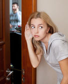 Jealous wife, overhearing a phone conversation her husband — Stock Photo