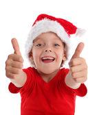 ευτυχισμένο παιδί με το καπέλο χριστούγεννα — Φωτογραφία Αρχείου