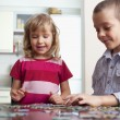 Children, playing puzzles — Stock Photo #5048907