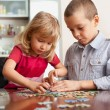 Children, playing puzzles — Stock Photo #5048908