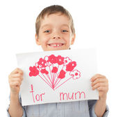 Child with drawing for mum — Stockfoto