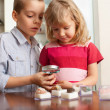 Children are considering a magnifying glass collection of stones — Stock Photo #5163940