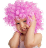 Beautiful little girl in pink wig — Stock Photo