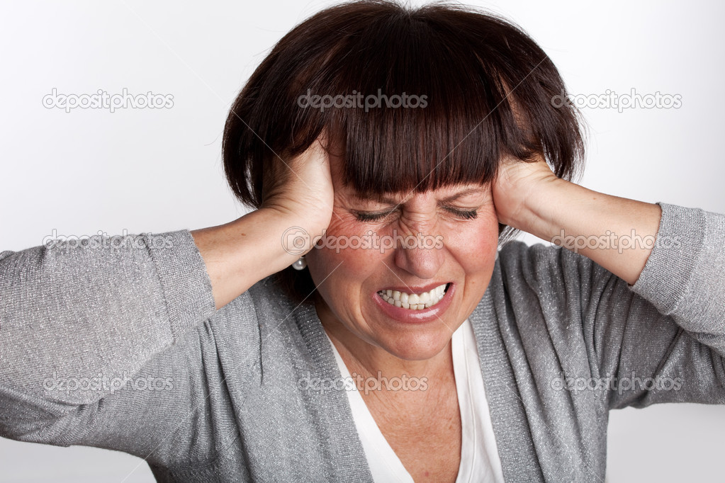Sadness mature woman. Isolated on gray — Stock Photo #5267019