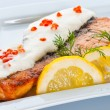 Steak from a salmon with creamy sauce and caviar - Stock Photo