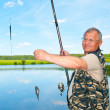 Stock Photo: Fisherman on river