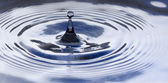 Water drop splashing — Stock Photo