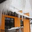 Icicles on roof in cols winter — Stock Photo