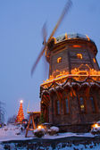 Windmill with christmass decorations — Stock Photo
