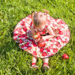 Girl sitting on the grass with apples — Stock Photo