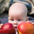 Small child holding both hands two apples — Stock Photo
