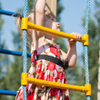 Stock Photo: Girl climbs on ladder of child