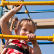 Girl climbs on the ladder of child — Stock Photo