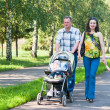 Royalty-Free Stock Photo: Happy family walks in the park