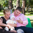 Portrait of a happy family in a summer park — Stock Photo