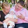 Portrait of a happy family in a summer park — Stockfoto