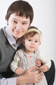 Portrait beautiful and happy fathers with a daughter — Stock Photo