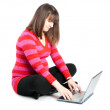 Royalty-Free Stock Photo: The pregnant woman works behind the laptop