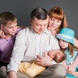 All family looks at the baby — Stock Photo
