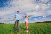 Wide angle portrait of young couple — Stock Photo