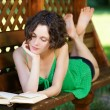 Girl with book outdoors — Stock Photo #4015007