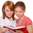Stock Photo: Two girls reading book