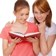 Two girls reading book — Stock Photo