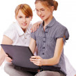 Two girls with notebook — Stock Photo