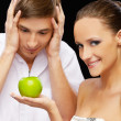 Young couple with apple - Stock Photo