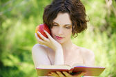 Girl with book outdoors — Stock Photo
