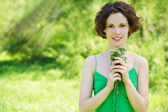 Girl with posy outdoors — Stock Photo