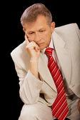 Thoughtful older businessman — Stock Photo