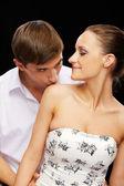 Guy zoenen meisjes schouder — Stockfoto