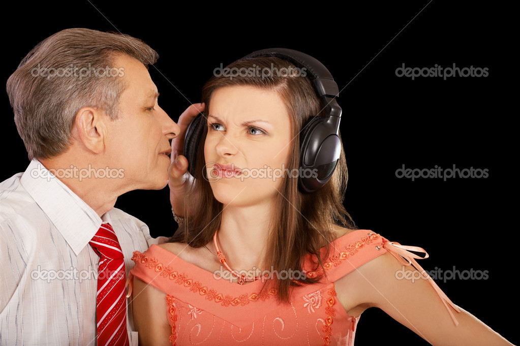 Expression family portrait of senior man pulling of headphone from offended girl's head — Stock Photo #4016152