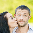 Woman kisses in on cheek man — Stock Photo