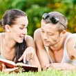 Stock Photo: Beautiful couplereads book