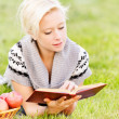 Charming girl reads book. - Stock Photo