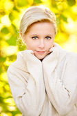 Fair-haired girl in white sweater — Stock Photo