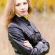 Stock Photo: Portrait of young womin black jacket