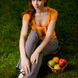 Beautiful girl sits on green grass - Lizenzfreies Foto