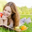 Girl with book and apples — Stock Photo #4170311