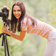 Beautiful girl with camera - Stockfoto