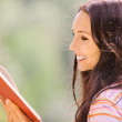 Lovely young woman reads book — Stock Photo #4199084