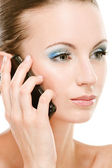 Young woman calls on cellular telephone — Stock Photo